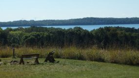 Benches surround a firepit on a hill overlooking Lake Mendota